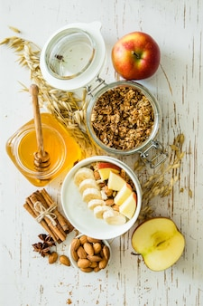 Autumn granola with banana apples and almond