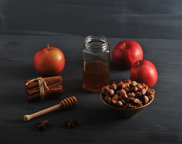 Autumn harvest with apples, honey, nuts, cinnamon