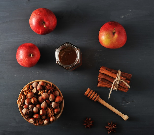 Autumn harvest with apples, honey, nuts
