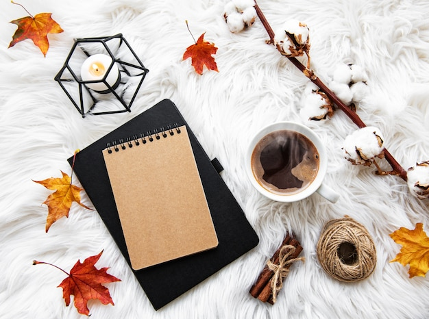 Autumn home cozy composition with coffee cup