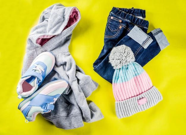 Autumn kids cloth concept, children's warm autumn clothes