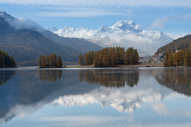 Autumn landscape of a lake in the swiss alps of the engadine val