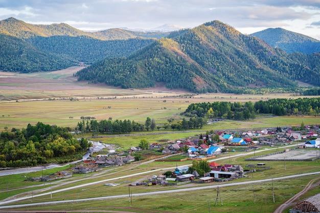 Autumn landscape with a mountain village russia mountain altai village of bichiktuboom