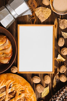 Autumn leaves and food around frame