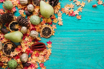 Autumn leaves and organic products on blue background