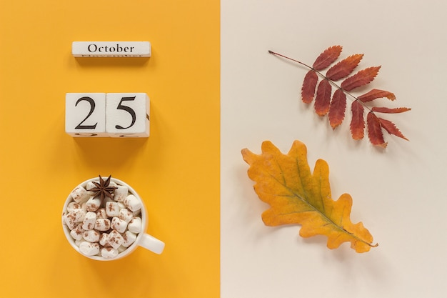 Autumn leaves, hot beverage and calendar