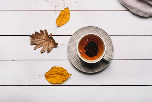 Autumn leaves near tea