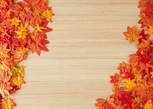 Autumn leaves on a wooden table background