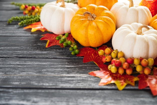 Autumn maple leaves and pumpkin on old wooden background. thanksgiving day concept.