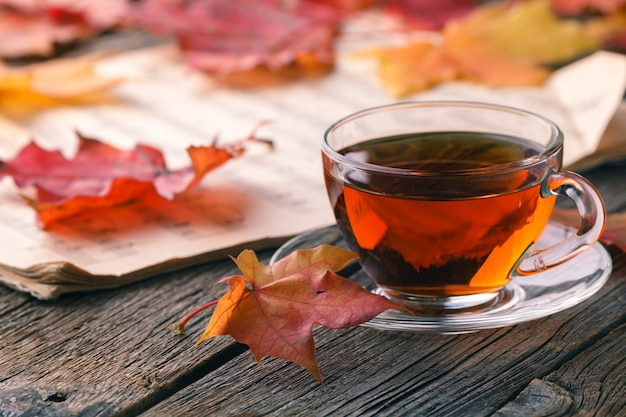 Autumn maple leaves on rustic table