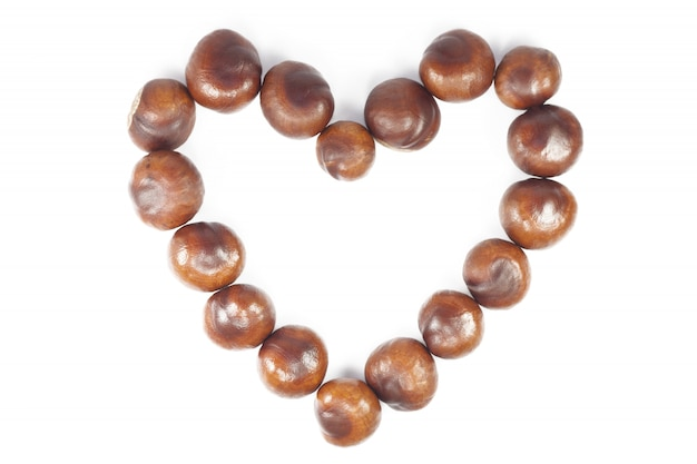 Autumn natural chestnut heart-shaped frame on white background