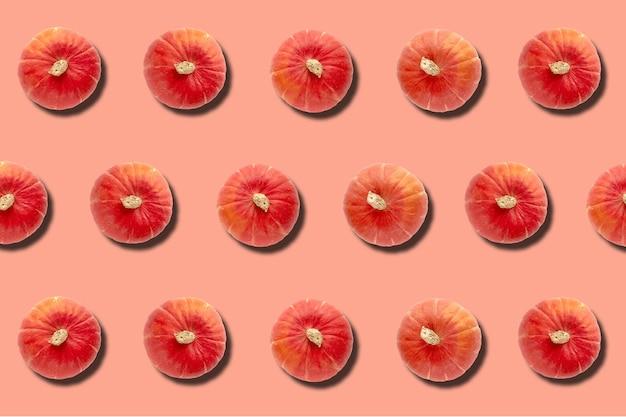 호박 분홍색 배경으로 만든 가을 패턴입니다. 템플릿 모형 가을, 할로윈, 프리미엄 사진