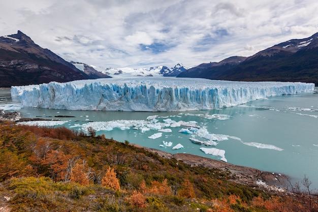 Autumn in perito moreno national park blue glacier field