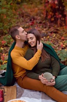 Autumn picnic with pumpkin, apples, tea
