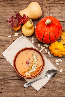 Autumn pumpkin cream soup. traditional ingredients, healthy food concept.