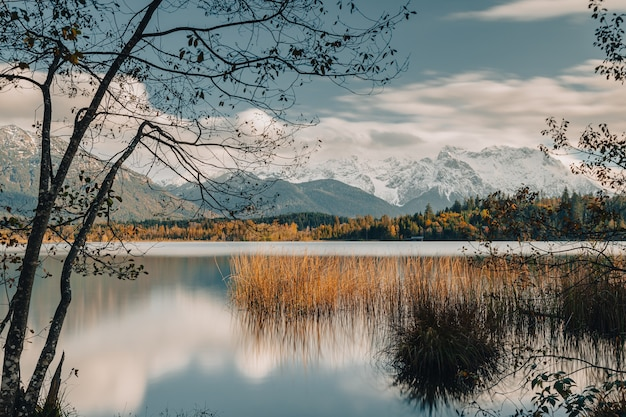 Autumn reflections on the lake against the snowy mountain backdrop
