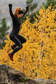 Autumn running outdoors workout yellow leaves