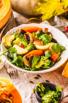 Autumn salad with baked pumpkin, beet, zucchini and carrots