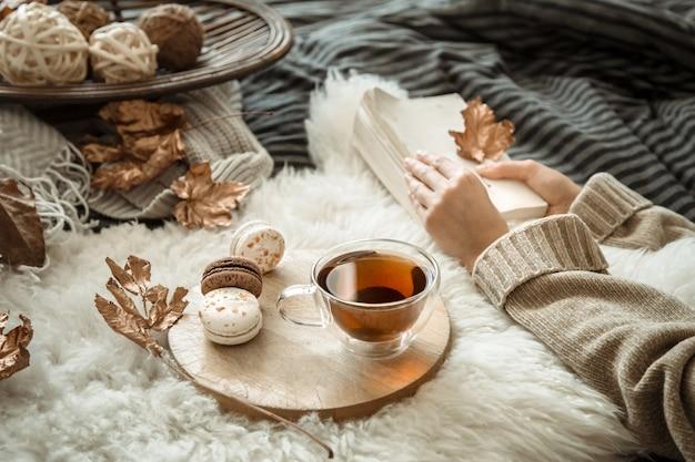 Autumn still life girl holding a cup of tea.