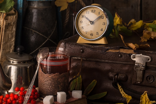 Autumn still life with books, vintage suitcase.