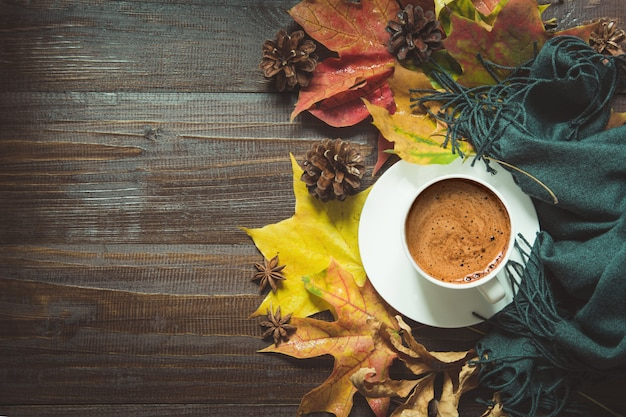 Autumn still life with cup of black coffee,