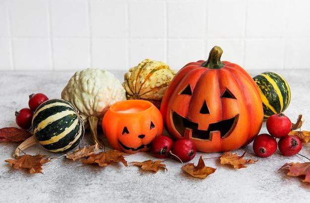 Autumn still life with halloween pumpkins on the table Premium Photo