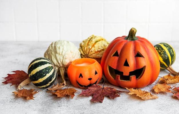 Autumn still life with halloween pumpkins on the table