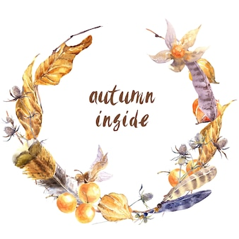 Autumn stories wreath. yellow fallen dry leaves, wild feathers, twigs, flowers and berries isolated