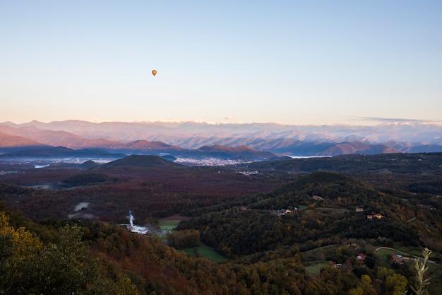 Autumn sunrise in the top of mountain in la garrotxa, spain.