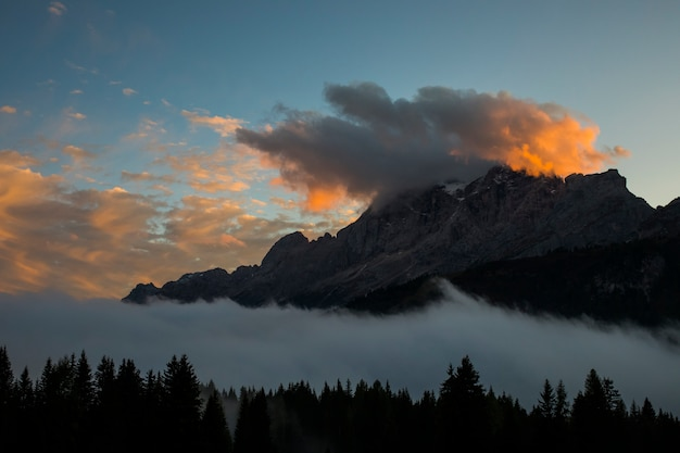 Autumn sunset in dolomites mountains