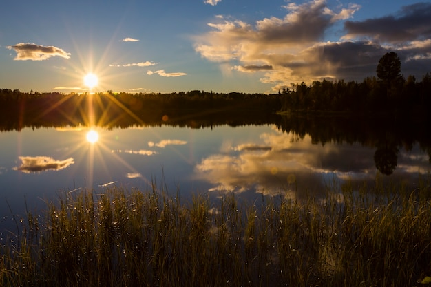 Autumn sunset in a lake in lapland, northern sweden.