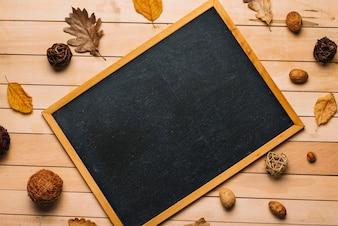 Autumn symbols around blackboard