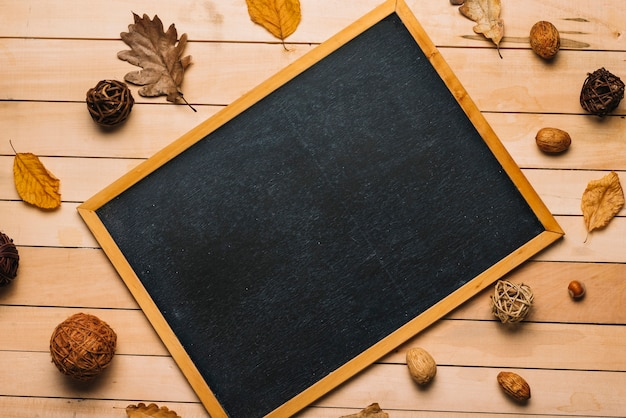 Autumn symbols around blackboard
