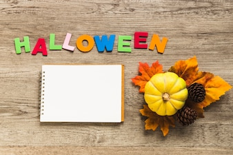 Autumn symbols near notebook and Halloween writing