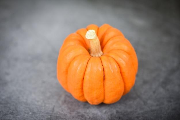 Autumn table setting with pumpkins holidaythanksgiving  decoration festive or halloween dark