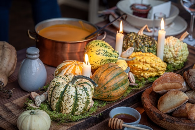 Autumn table setting with pumpkins. thanksgiving holiday dinner and fall decoration.