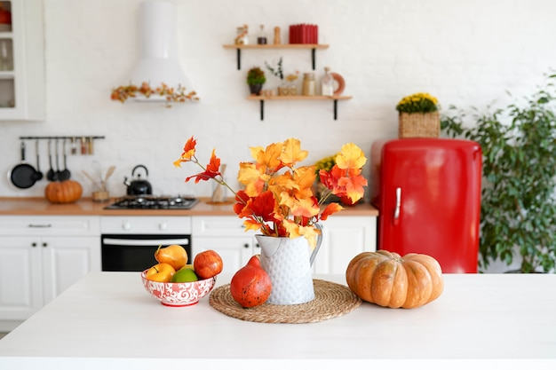 Autumn table with vegetables in kitchen.