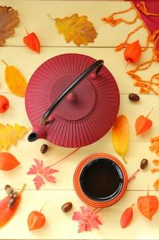 Autumn tea drinking. burgundy teapot in asian style