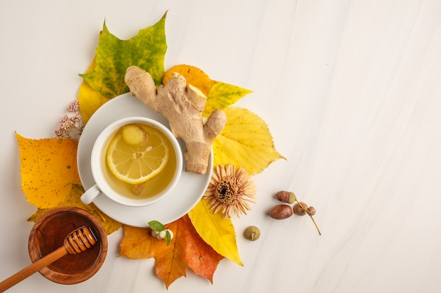 Autumn tea with ginger and lemon on a white background, copy space.