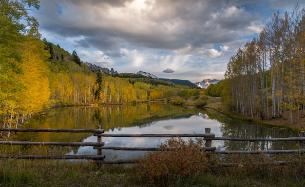 Autumn in telluride with sun light and reflection on the lake