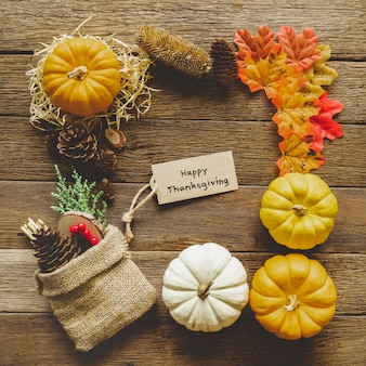 Autumn thanksgiving day background with pumpkins and decorations frame