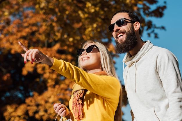 Autumn travel couple enjoying picturesque fall landscape view
