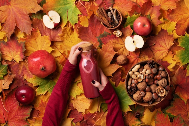 Autumn vegan and vegetarian food concept - apples, pomegranate, nuts, spices. picnic time.