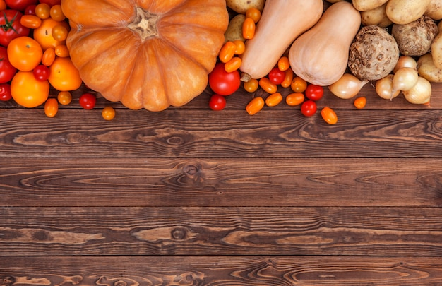Autumn vegetables background, top view