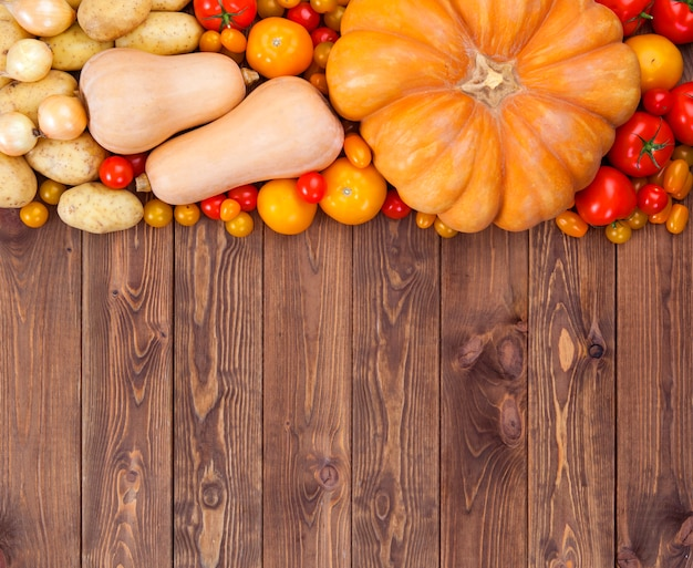 Autumn vegetables harvest on wooden surface