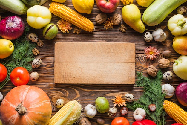 Autumn vegetables with wooden board in middle