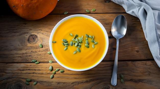 Autumn vegetarian pumpkin cream soup with seeds. top view