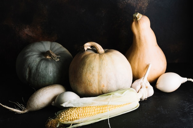 Autumn veggies assortment with pumpkin and corn