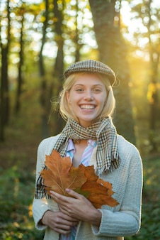 Autumn woman autumn is a beautiful time of year outdoor portrait of beautiful happy girl walking in ...