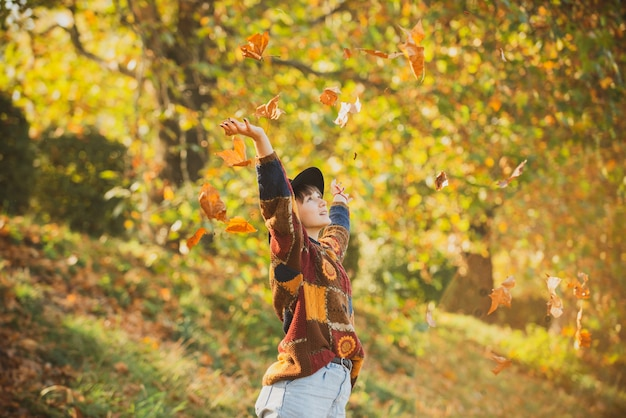 Autumn woman in autumn park young woman enjoying sunny weather fall mood young woman with beautiful ...